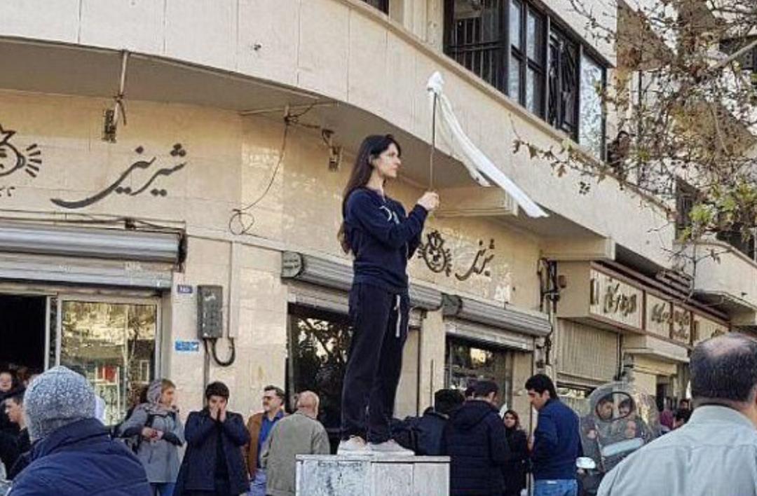 Vida Movahed protesting in Tehran, Iran