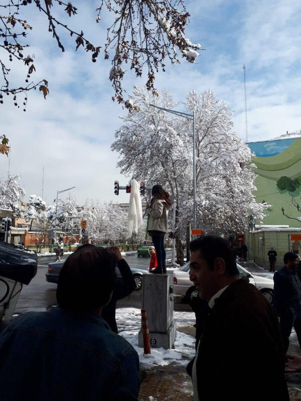 Woman protesting in Iran